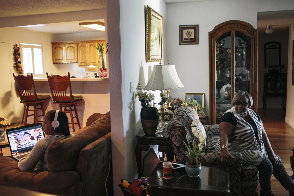 Lee Tidwell, right, sits and her eldest daughter Patricia Tidwell spend time in their home in Los Angeles. Tidwell received an energy efficiency upgrade to her home in the Compton neighborhood of L.A., which inluded a $3000 rebate. Tidwell used the money to pay for her youngest daughter's wedding in Las Vegas.